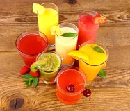 Fruit juices, kiwi, raspberries, cherry, orange, strawberry and pineapple Stock Photography