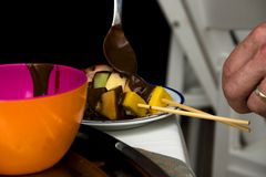Fruit kabobs with chocolate sauce Stock Photo