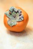 Fruit kaki sur le bois Photo libre de droits
