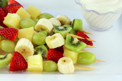 Fruit Kebab. Fresh fruit Kebab made of strawberries, Grapes, kiwis, bananas and pineapples. Shallow Depth of Field royalty free stock images