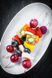 Fruit kebabs with berries and tropical fruit Stock Photography