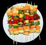 Fruit Kebabs on White Plate Stock Images