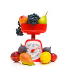 Fruit and kitchen scale on white background Royalty Free Stock Photography