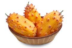 Fruit Kiwano in a wicker basket Royalty Free Stock Images