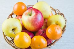 Fruit large red ripe apples and tangerines Royalty Free Stock Images