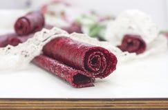 Fruit leather rolls, closeup shot Stock Photos