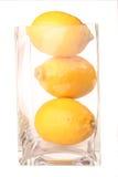 Fruit - Lemon isolated. The juicy fruit of lemon in a glass jar Stock Photo
