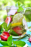 Fruit lemonade with strawberry in a pitcher . Royalty Free Stock Images