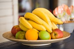 Fruit lies on a wooden dish Royalty Free Stock Images