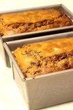 Fruit loaves in tins Stock Image