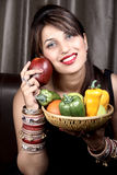 Fruit lover. Beautiful indian model girl holding fruits and vegetables in basket stock images