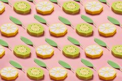 Fruit made of paper. Pink background. There`s room for writing. Tropics. Flat lay. Kiwi, lemon. Pattern of fruit made of paper. Pink background. There`s room for stock photos