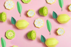 Fruit made of paper. Pink background. There`s room for writing. Tropics. Flat lay. Kiwi, lemon. Pattern of fruit made of paper. Pink background. There`s room for royalty free stock photography