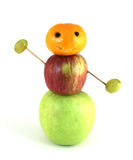 Fruit man. Like a snowman, but made of fruit.  Concept of healthy eating, you are what you eat Royalty Free Stock Photography