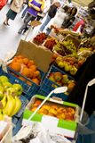 Fruit market. A busy fruit market in Prague, focus is on the fruit royalty free stock photos