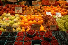 Fruit market. With oranges, apples, pears, berries and grapes Royalty Free Stock Photos