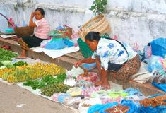 Female sellers at the fruit market in Asia Royalty Free Stock Photos