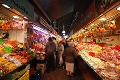 Fruit market in Barcelona. Tourists in the La Boqueria market in Barcelona Stock Images