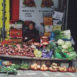 Fruit market in Busan, South Korea. Grandma at her market stall in South Korea Royalty Free Stock Images