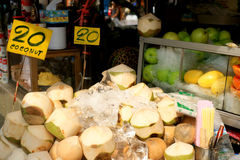 Fruit market. Coconuts. Stand with coconuts, price twenty Baht per share. Thailand, Bangkok, 2012 Stock Photography