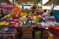 Fruit market with colorful fruits and vegetables Stock Images