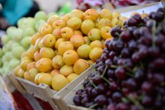 Fruit market. Colorful, tasty fruit in baskets at a market. Uzbekistan Royalty Free Stock Photo