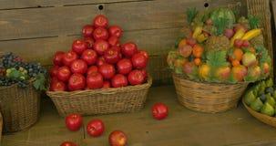 Fruit Market. Fresh fruit assortment in baskets on wooden shelf stock footage