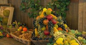 Fruit Market. Fresh fruit assortment on wooden shelf stock footage