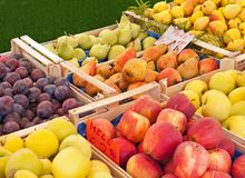 Fruit at the market in Italy. Apples, pears, and plums at the market in Italy stock photo