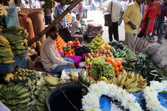 Fruit market in Kolkata. Street trader sell fruits outdoor on February 11, 2014 in Kolkata India. Only 0.81% of the Kolkata`s workforce employed in the primary Royalty Free Stock Image