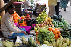 Fruit market in Kolkata. Street trader sell fruits outdoor on February 11, 2014 in Kolkata India. Only 0.81% of the Kolkata`s workforce employed in the primary Stock Image
