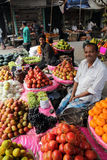 Fruit market in Kolkata. Street trader sell fruits outdoor on February 11, 2014 in Kolkata India. Only 0.81% of the Kolkata`s workforce employed in the primary Stock Photo