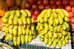 Fruit market in Mapusa. Fresh exotic fruits and bunches of ripe bananas at the market in Mapusa.Goa Stock Image