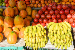 Fruit market in Mapusa. Fresh exotic fruits and bunches of ripe bananas at the market in Mapusa.Goa Royalty Free Stock Images