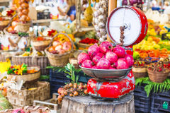 Fruit market with old scales and garnet Stock Photo
