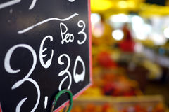 Fruit market pricing sign in euro. Three euro price sign in french market Stock Images