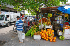 Fruit market situated on the harbor of Male. MALE, MALDIVES - JULY 1: Uknown people at fruit market situated on the harbor of Male, capital city of Maldive Royalty Free Stock Photos