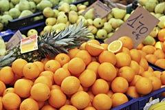 Fruit market Spain. Oranges, pineapple pear royalty free stock photo