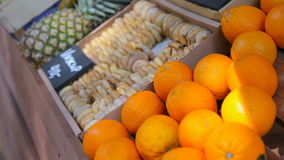 Fruit market with various colorful fresh fruits and vegetables. On the bench are oranges, figs, pineapples stock video footage