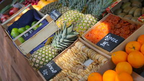 Fruit market with various colorful fresh fruits and vegetables. On the bench are oranges, figs, pineapples stock video