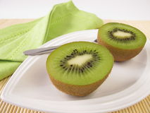 Fruit meal with kiwifruits. On plate Stock Photo