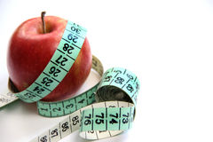 Fruit and measurement tape on the white background Stock Photography