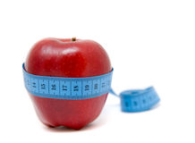 Fruit with measuring tape Royalty Free Stock Photo