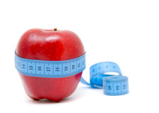 Fruit with measuring tape Stock Photo