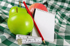 Fruit with measuring tape Stock Photos