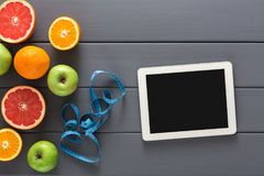 Fruit, measuring tape and blank tablet mockup Stock Images
