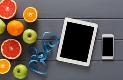 Fruit, measuring tape and blank tablet mockup Royalty Free Stock Image