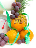 Fruit, measuring tape and scales Stock Photography