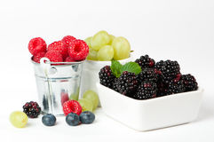 Fruit Medley. Medley of fruit on white background including raspberries, blackberries and grapes royalty free stock photo