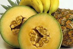 Fruit melon bananas pineapple Stock Images